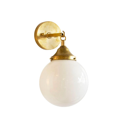 Hand Rubbed Antique brass hardware with orb globe light and opal glass. Meant for a bathroom or hallway.