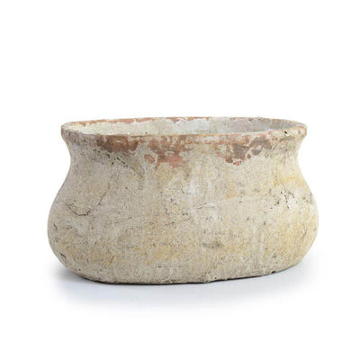 The Copan Bowl is an oval clay planter with a antiqued stone finish.