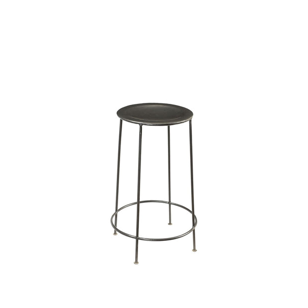 The Nashville Counter Stool is handmade from salvaged zinc steel and has hand-hammered dimpling details on the seat.
