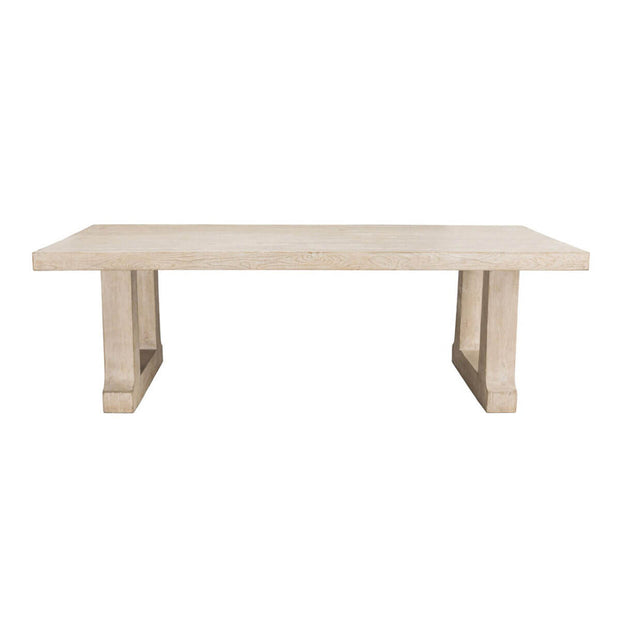 The Bremen Dining Table is made of hand-finished, whitewashed pine and has thick-cut trestle legs.