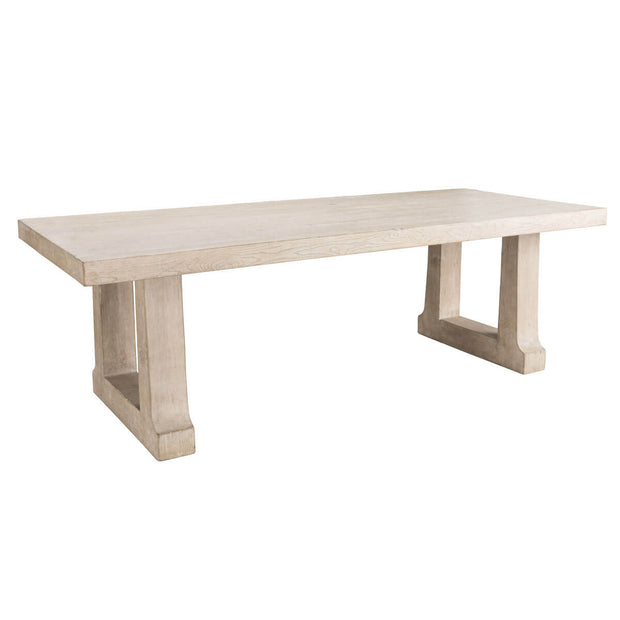 Large, solid wood dining table with thick trestle legs.