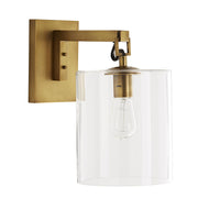 Glass cylinder wall light with a brass backplate and arm.