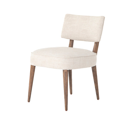 The Pearsonville Armless Dining Chair boasts a natural elegance with a modern rustic aesthetic.