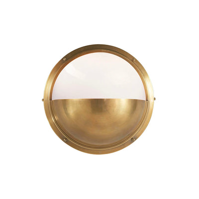 The Pelham Moon Light is a half sphere globe combining antique brass with white glass.