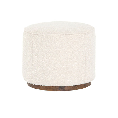 This small round ottoman, upholstered in white boucle fabric, is perfect for any living room.