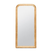Gold leaf full body mirror with a rounded top and thick frame.