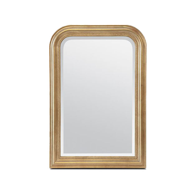 Classic mirror with a beveled, gold-leaf frame with a rounded top.