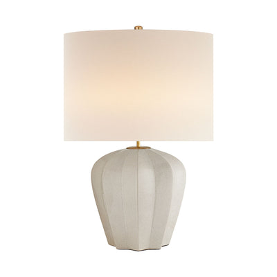 Contemporary modern table lamp with a white linen shade, glazed crackled finish on the decoratively shaped base, and warm brass details.