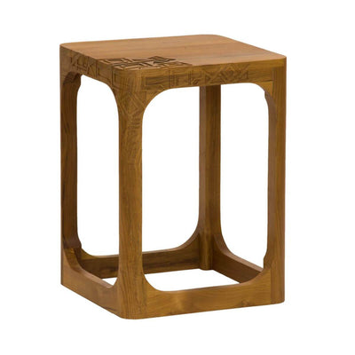 The Hilo Side Table is a cube shaped side table made of teak wood with tribal carving details.