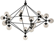 Large abstract statement chandelier with metal arms and clear glass globes in a black finish.