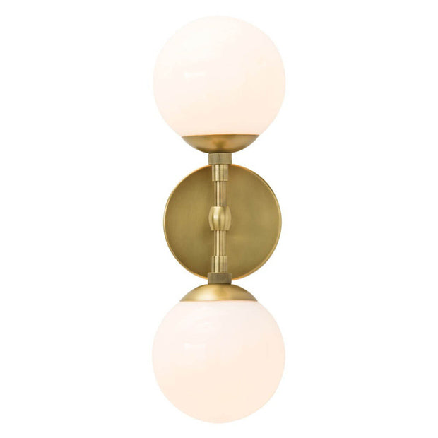 The Navala Wall Sconce in a antique brass finish with frosted glass globe lampshades.