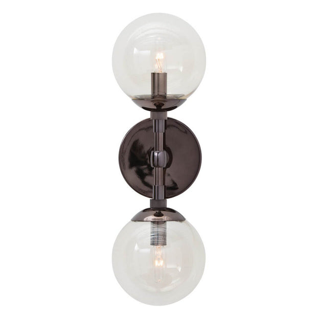 The Navala Wall Sconce in a brown nickel finish with clear glass globe lamp shades.