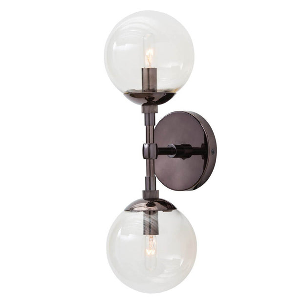 Brown nickel wall sconce with double glass lamp shades mounted vertically.