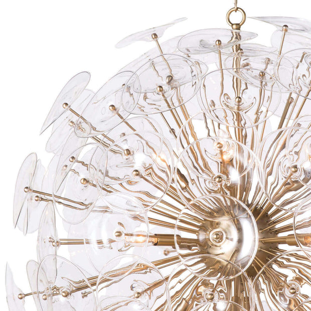 Candelabra bulbs shine through clear glass discs, attached to natural brass rods.