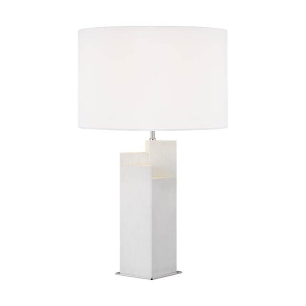 The Sunmor Table Lamp in an arctic white finish and polished nickel details with a white linen shade.