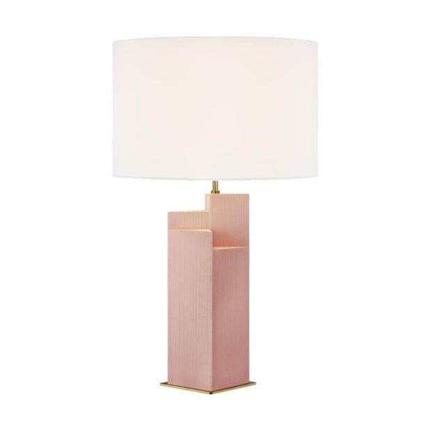 The Sunmor Table Lamp in a blush and burnished brass finish with a white linen shade.