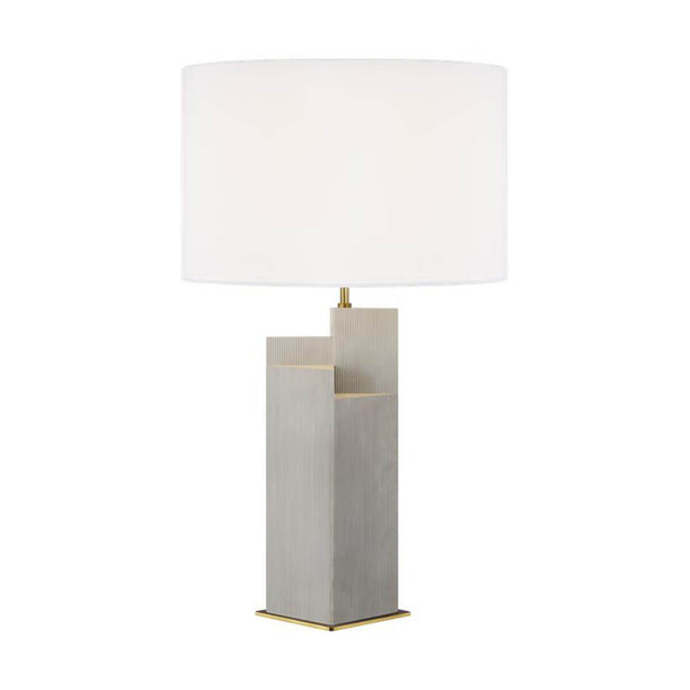 The Sunmor Table Lamp in a natural and burnished brass finish with a white linen shade.