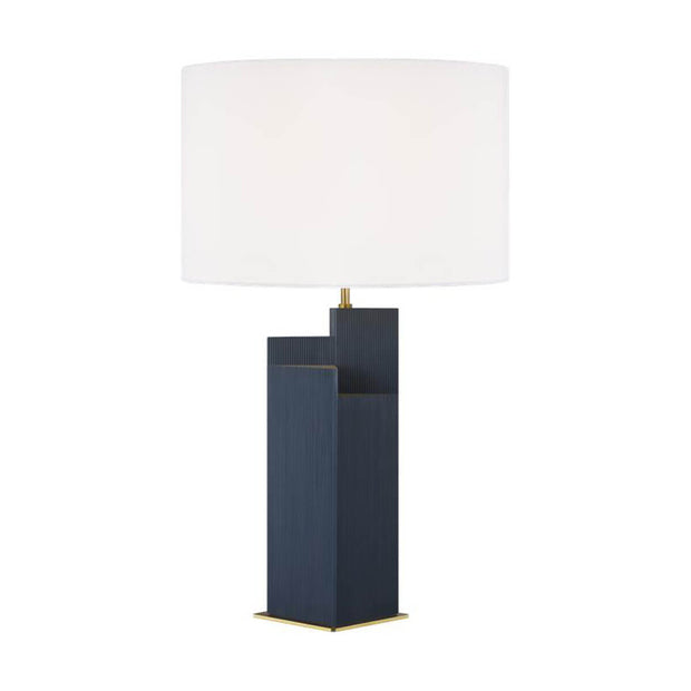 The Sunmor Table Lamp in a royal blue finish and burnished brass details with a white linen shade.