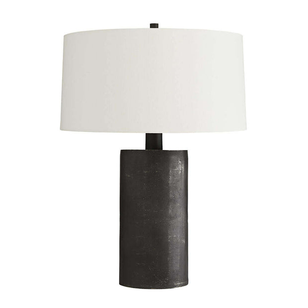 The Karlin Table Lamp in a matte black graphite finish and off-white linen drum shade for a raw industrial look.