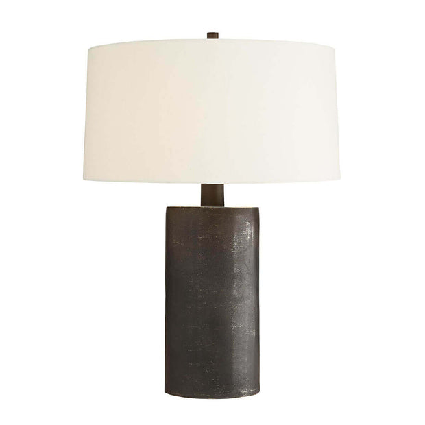 Dark statement table lamp with a matte black graphite aluminum body and off-white linen shade.