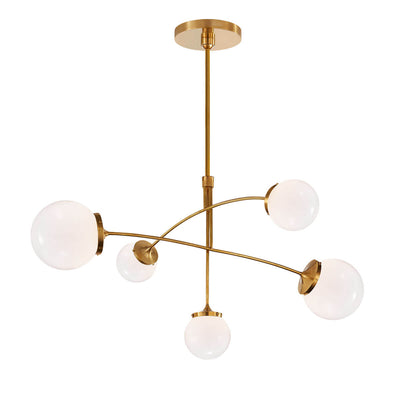 The Prescott Mobile Chandelier has 5 white glass globe shaped shades and soft brass rods in a solar system diorama shape.