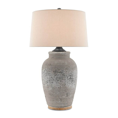 The Doha Table Lamp is a textured living room table lamp with concrete base in a rustic grey finish and a sand linen shade.