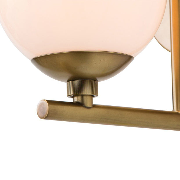 Frosted glass lamp shade and L shaped metal arm on the minimal hallway light.