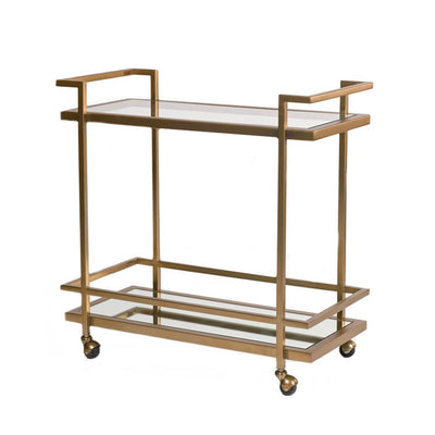 Luxurious antique brass bart cart with two shelves and wheels.