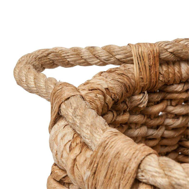 Rope handle on the banana leaf woven basket.