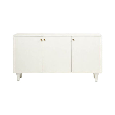 The Memphis Sideboard in a white faux raffia finish with a simple shape and gold knob details and three doors.
