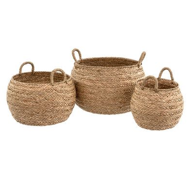 The Recife Seagrass Baskets are handcrafted from grass in a delicate herringbone weave.