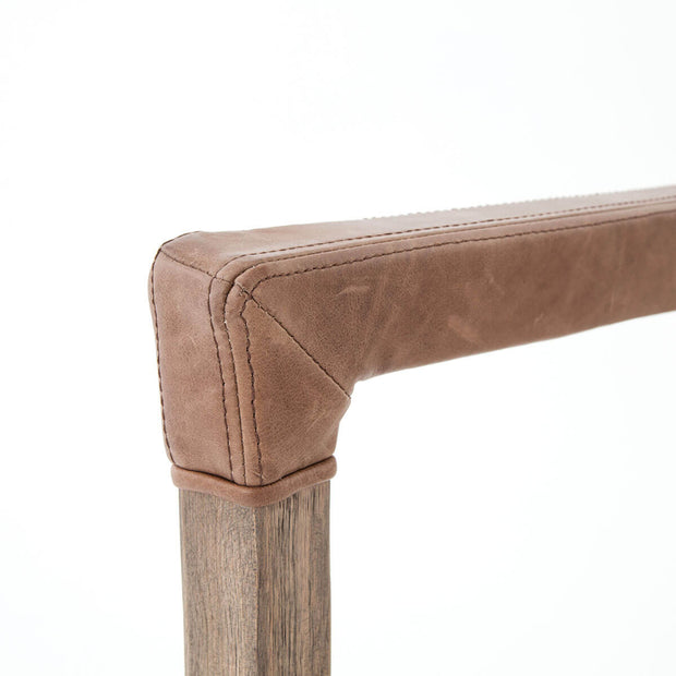 Antique leather arm wrap on the solid oak base of the modern dining chair.