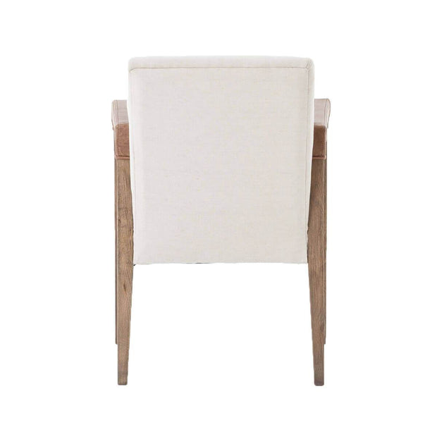 Back view of the Montpelier Dining Chair with a white linen backrest and tapered oak legs.