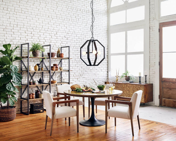 Elegant arm chairs in a modern dining room with a round table.