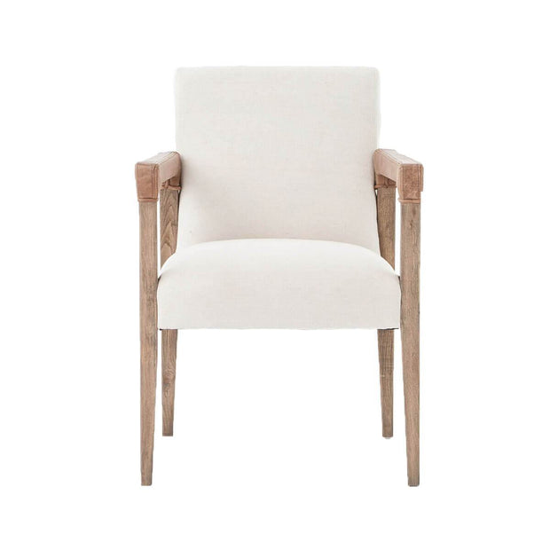The Montpelier Dining Chair has a an oak base, natural linen covered seat and antique leather arm details.
