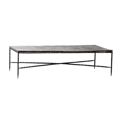 The Ludlow Coffee Table has slender, iron legs and an aluminum tabletop in a bronze finish.