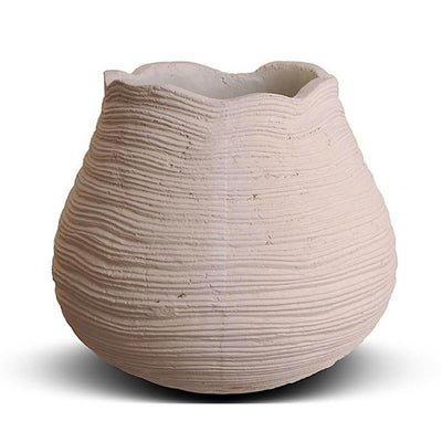 The Tikal Large Pot is a large urn shaped, concrete planter with a scalloped edge.