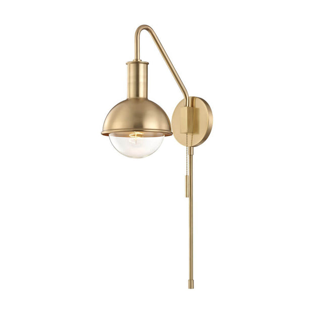 The modern Minsk Wall Sconce in a aged brass finish.