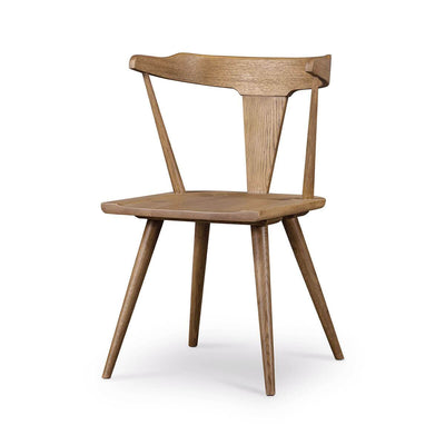 Modern dining chair with a rounded back, angled legs in a light oak finish.