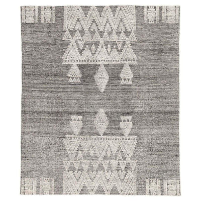 The Hillwood Rug is a artisan hand-knotted rug with a grey and white geometric pattern and a bohemian look.
