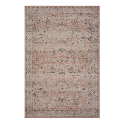 Blush and neutral toned rug with intricate faded design.