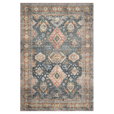 The Lucerne Sea / Rust Rug is a blue and dark red, power-loomed rug with a traditional pattern.