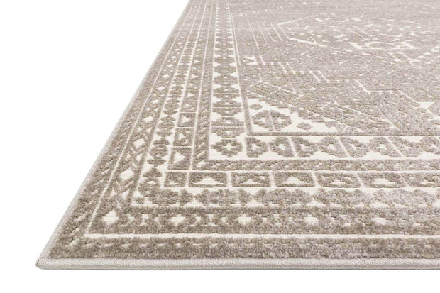 Geometric patterned runner in a light brown and white colour palette.