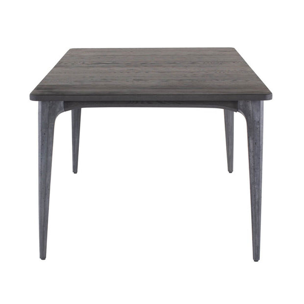 Side view of a black modern dining room table with a solid wood top, concrete legs, and utilitarian design.