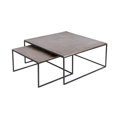 Modern nesting tables with a black frame and top with an antique brass finish.