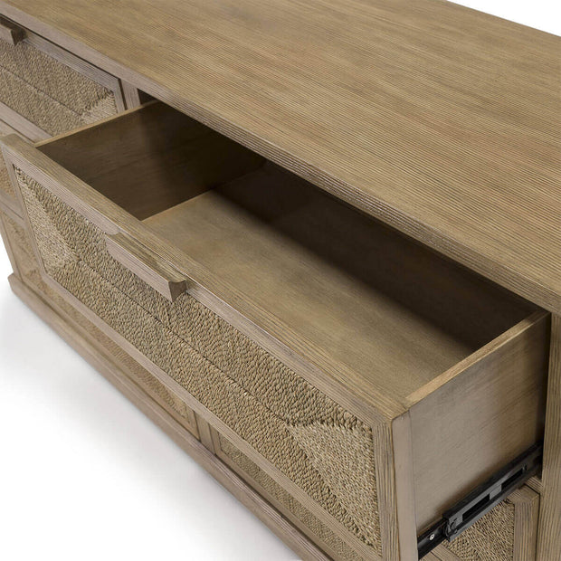 Closeup of the open drawer on the light brown hardwood chest with three drawers and hand-woven rope drawer fronts.