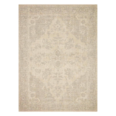 Hand-woven neutral rug with subtle pattern.