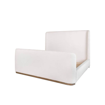 Bed with a white ivory upholstered bed frame with rounded edges and a modern look.