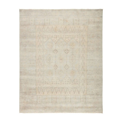 Hand-knotted, artisan made area rug made of 100% wool. Soft patterned rug with pale grey and beige tones.