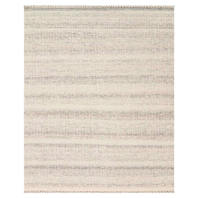 The Sauble Beach Rug in the colour Smoke, is made up of grey and white tones that form a subtle stripped pattern. Handwoven, textural rug made of wool, polyester, and cotton.